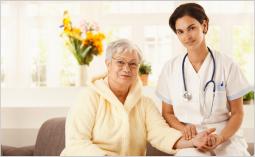 an elderly with her nurse