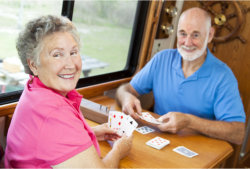two elderly playing cards