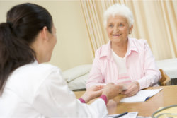 a nurse talking to her patient