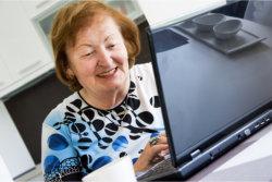 an elderly using a laptop